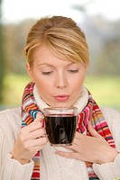 Woman drinking elderberry juice