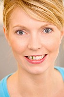 Woman having spinach between her teeth