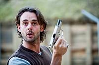 Man holding 9mm gun