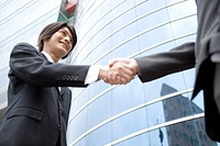 Businessman shaking hands with a man, low angle view