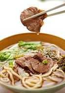 Bowl of beef with noodles