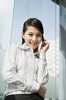 Young businesswoman on the phone smiling