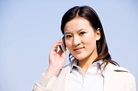 Young businesswoman on the phone, smiling, portrait