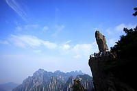 China, Anhui Province, Mt. Huangshan, tourists with Flying Stone