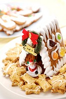 Gingerbread house, cookies and Santa Claus