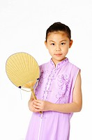 Girl in traditional dress hold a fan