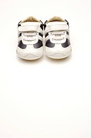 A pair of black and white baby shoes