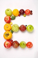 Fruits and vegetables in the shape of letter E, close_up