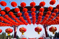 Red lanterns decorate the memorial archway of Ditan during Ditan Spring Festival Temple Fair, Beijing, China