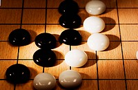 Close_up of Weiqi game board with game in session