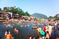 Tourists enjoying a swim in the Tuo River, Fenghuang Ancient Town, Hunan Province, China