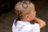 Chinese boy with Olympic logo hair cut, Beijing, China