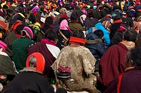 Monks and pilgrims during a religious ceremony in a local Tibetan Buddhism monastery, Garz¨º Tibetan Autonomous Prefecture, Sichuan Province, China