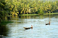 COUNTRY BOATS MOVING GENTLY ACROSS AKKULAM LAKE TRIVANDRUM