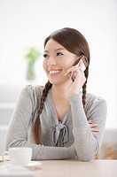 Young woman looking away and on the phone