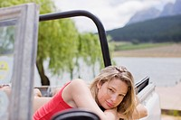 Woman sitting in jeep