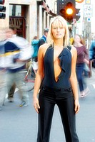 Model wearing Black stands still while people in background are blurred from their motion.Shot Melbourne August 2002.Agent 109 Ewing