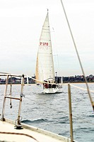 A view of a yacht from on board another in a race.Melbourne 2003 Agent 109 Ewing