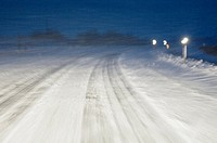 Snow_covered road. Driver´s_eye_view of a snow_covered road during a night_time snow_storm. Photographed in Nebraska, USA.