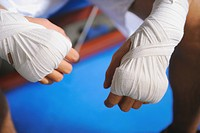 Boxer's hand and knuckles tied with bandage