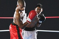 Japanese boxer hitting his opponent