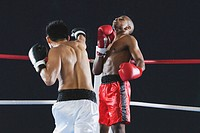 Two men fighting in Boxing ring