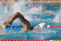 Young swimmer doing front crawl