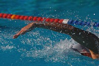 Young Australian swimmer doing butterfly stroke