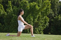 Young Woman in Low Lunge position of yoga