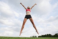 Young Woman jumping in the air