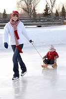 Mother boy skating rink.