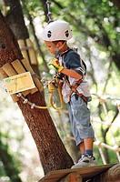 Child climbing trees