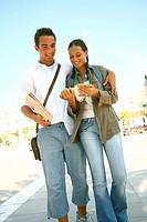 Teenage couple walk
