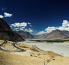 Road passing through mountain ranges, Shyok River, Nubra Valley, Ladakh, Jammu and Kashmir, India