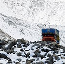 Truck passing through a mountain, Khardung La Pass, Ladakh, Jammu and Kashmir, India
