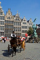 Belgium _ Flanders _ Antwerp _ Grote Markt, Grand Place _ The guild houses _ Brabo Fountain and statue of Silvius Brabo _ Fiacre