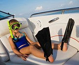 Young girl 6_8 wearing snorkeling gear in boat