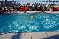 Woman swimming in pool, Gansevoort Hotel, Manhattan, New York City, New York State, USA