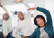 African couple exercising in health club (thumbnail)