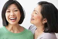 Filipino mother and daughter laughing