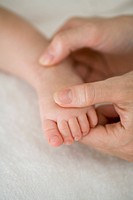 Mother touching baby's foot