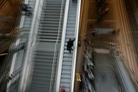 Commuters using stairs and escalators