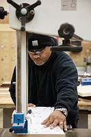 Pacific Islander man working in workshop