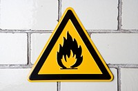 'Flammable' warning sign on wall