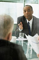 Businessmen discussing document in meeting