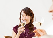 Woman drinking white wine