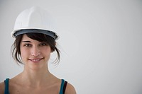 Teenage girl wearing a hardhat