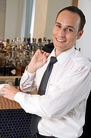 Businessman drinking espresso at a bar