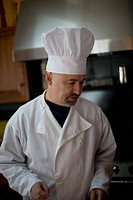 A chef standing in a kitchen