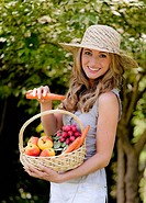 Fruit and vegetables in the basket with woman